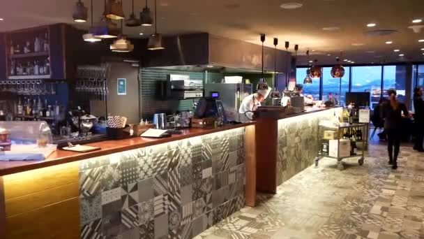 Restaurant Interior With Bar Stand And Staff
