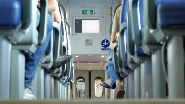 Passage In A Train Car Riding With Seated Passengers (Low Angle)