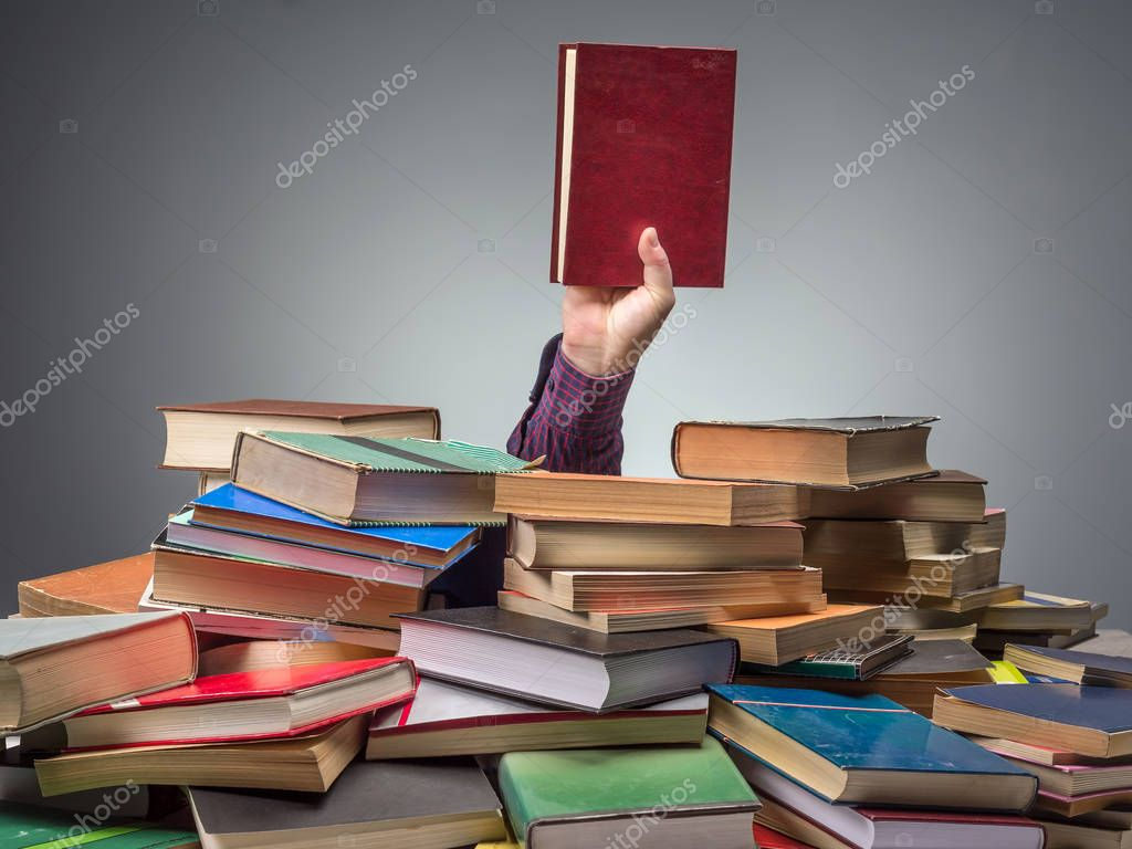 Man with book found among pile of books