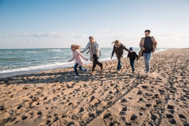 family walking together on seashore