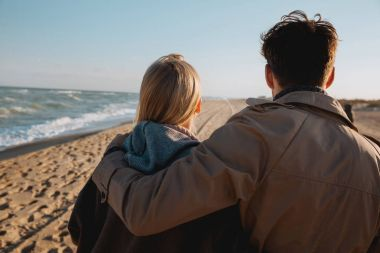 couple hugging at seaside