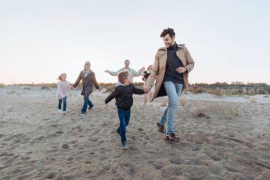 Multigenerational family on seashore