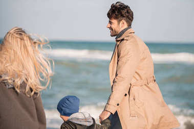 Parents with son walking on seashore