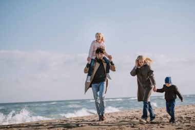 Parents and kids on seashore