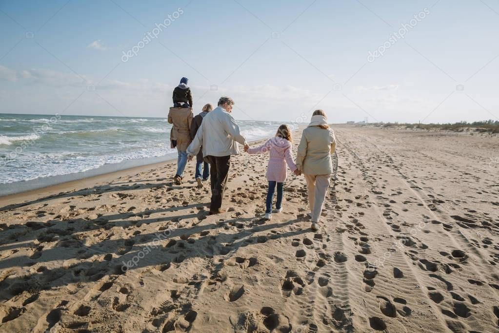 family walking at seaside