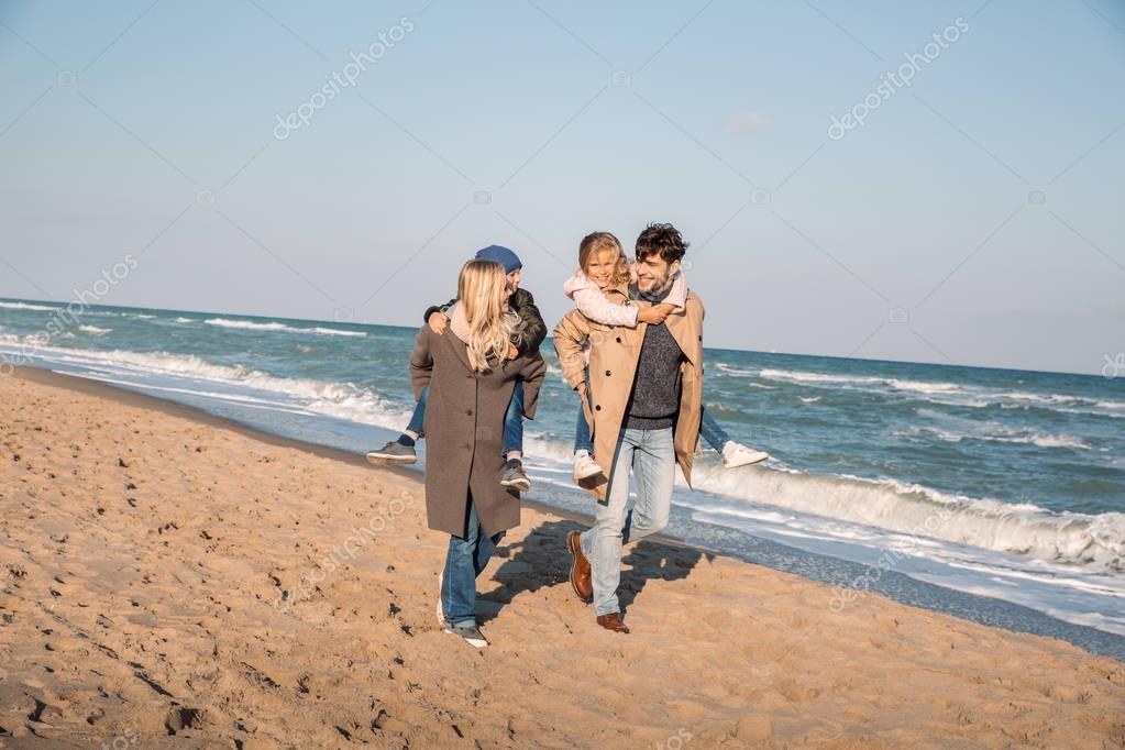 happy piggybacking family