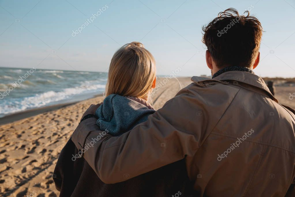 couple hugging at seaside