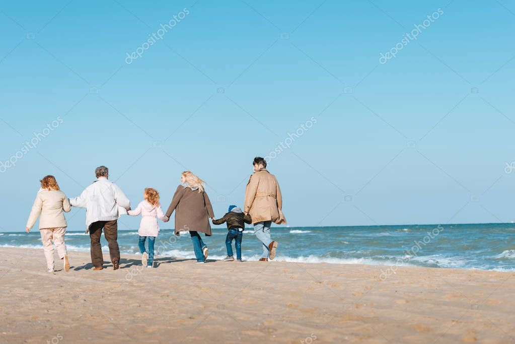 family walking at seashore