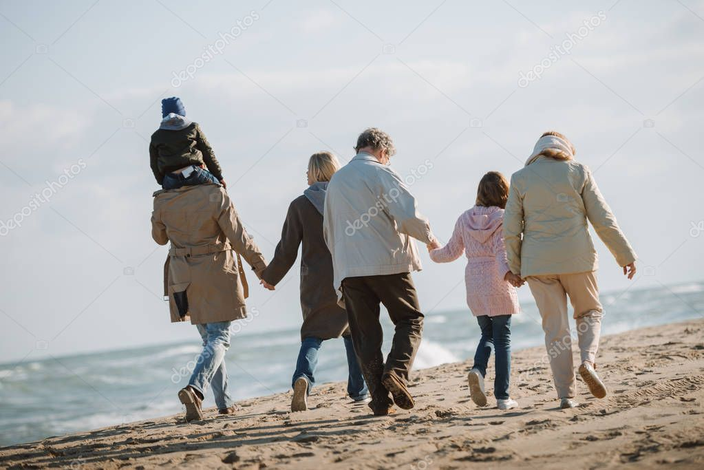 multigenerational family together on seashore