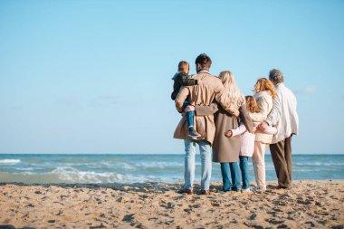 family spending time at seaside