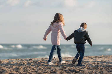 brother and sister holding hands