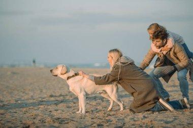 family with labrador dog