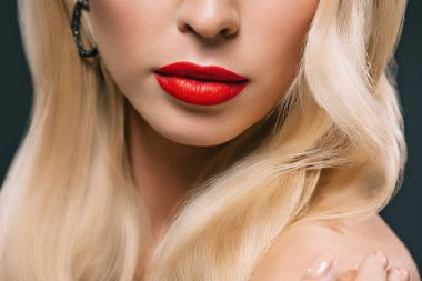 cropped view of model with perfect skin and red lips, isolated on grey