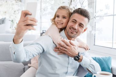 Daughter and father taking selfie in cafe stock vector
