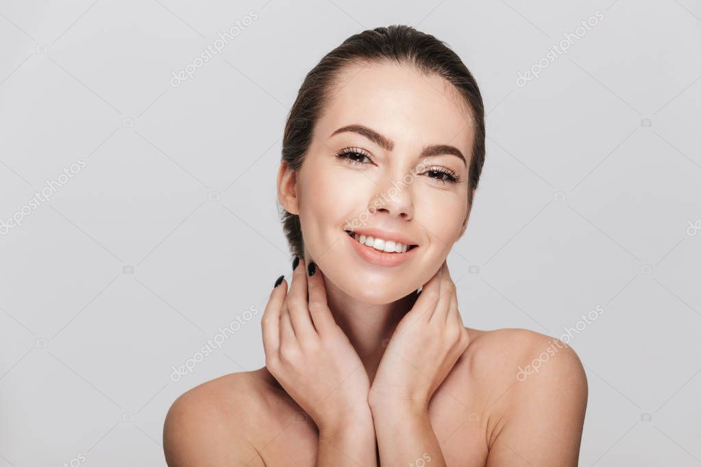 Smiling young woman with perfect skin isolated on white