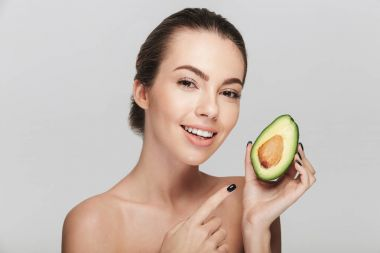 Happy young woman with half of fresh avocado isolated on white stock vector