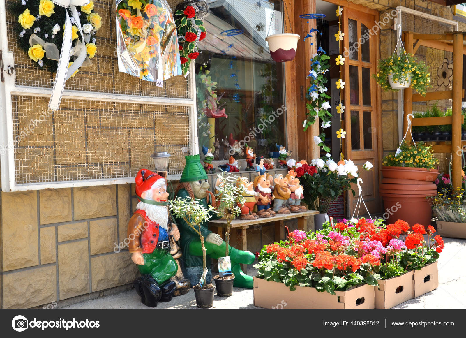 Display of flower shop containing flowers and garden – Stock ...