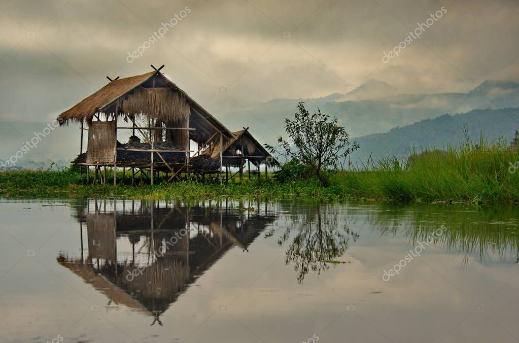 Shan. Myanmar. 11/27/2016. Due to the fact that lake Inle is clamped between the mountains, most huts and Buddhist temples on lake Inle are built on wooden piles right in the middle of the lake.