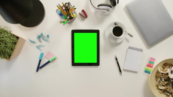 A Finger Touching a Tablet with a Green Screen