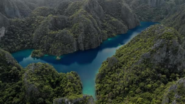 Aerial view of turquoise tropical lagoon with Karst limestone cliffs in Coron Island, Palawan, Philippines. UNESCO World Heritage Tentative List
