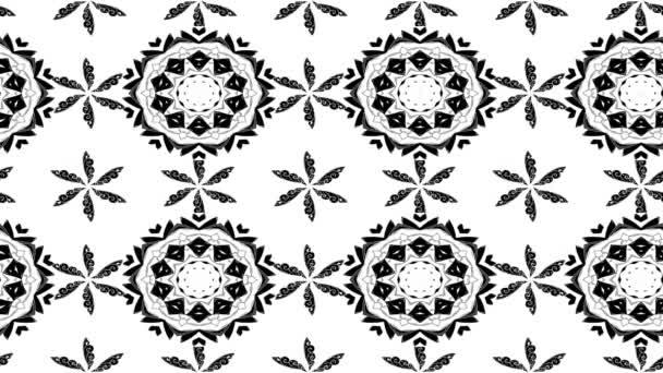 Fehér és fekete virágmintás mozgó
