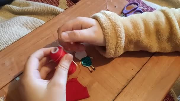 The girl is engaged in needlework at home.