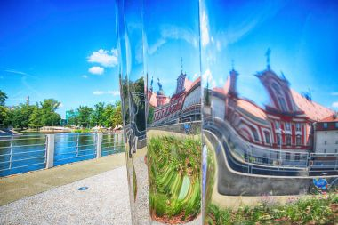 WROCLAW, POLAND - JULY 29, 2017: The NAWA sculpture designed by Oskar Zieta, erected on Daliowa Island. Due to polished steel surface NAWA reflects its surroundings (different feeling every time).