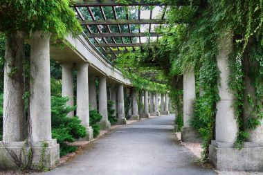 WROCLAW, POLAND - AUGUST 04, 2017: Pergola, a 640 meter long structure built in 1913 in the shape of a semi-ellipse as an integral part of the Centennial Halls Exhibition Grounds.