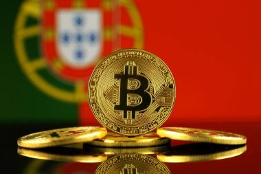 Physical version of Bitcoin (new virtual money) and Portugal Flag. Conceptual image for investors in cryptocurrency and Blockchain Technology in Portugal.