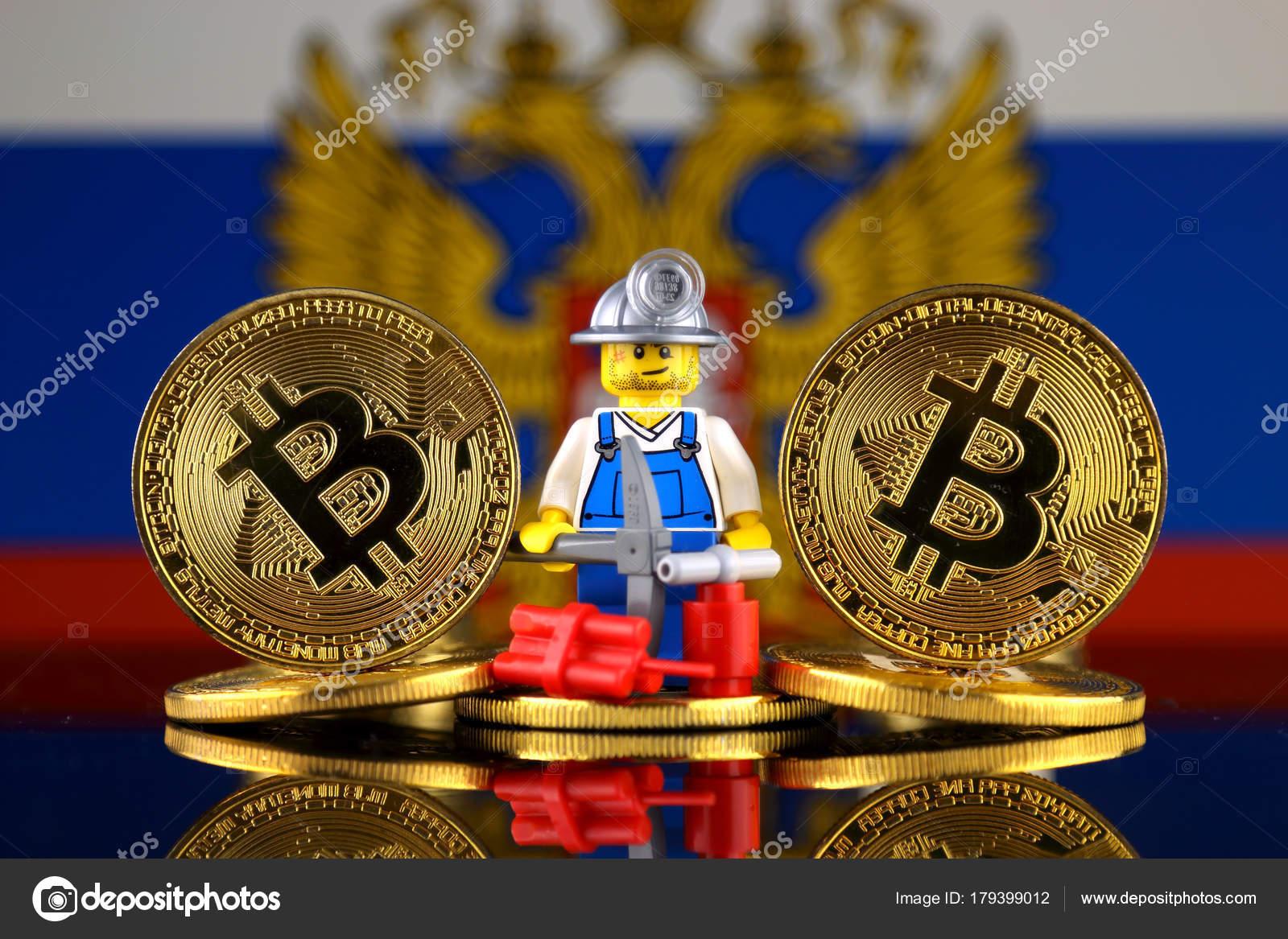 Verso fsica bitcoin mineiro bandeira rssia imagem conceitual verso fsica bitcoin mineiro bandeira rssia imagem conceitual minerao cryptocurrency fotografia de stock ccuart Choice Image