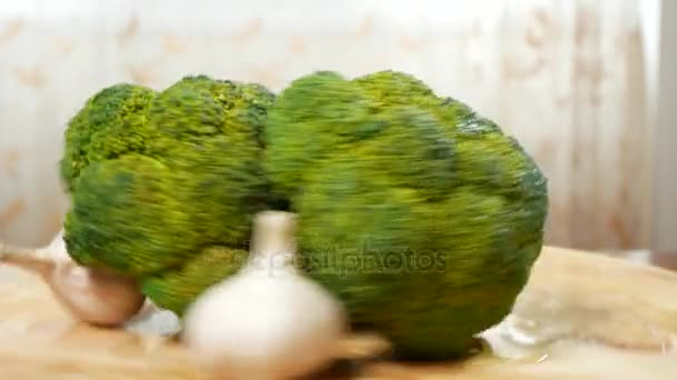 broccoli and garlic spinning on a wooden cutting board. 4k.