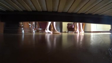 4k, view from under the bed, a couple of man and woman swear.