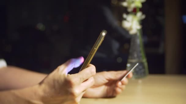 Woman uses a credit card and cellphone for online shopping, 4k, slow motion