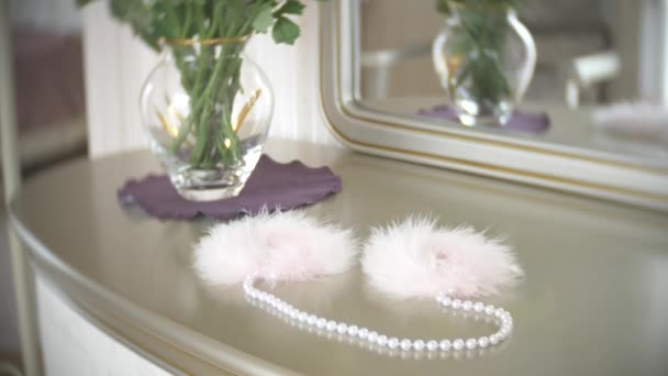Fur handcuffs. beautiful exquisite sex toys for adults on a table near the mirror in the bedroom. 4k, slow-motion, close-up