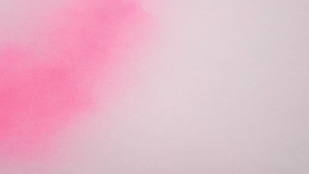 White sheet coloring with pink spray paint. copy space
