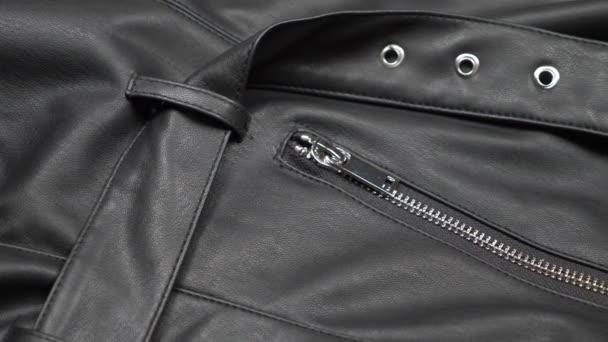 textura pozadí tkaniny. Faux kožená látka se zipem. detailní