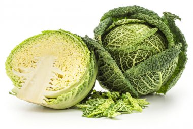 Savoy cabbage head and one section half with chopped leaves stack isolated on white background fresh gree