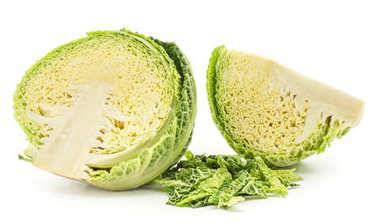 Savoy cabbage one half and sliced quarter with chopped leaves stack isolated on white background fresh gree