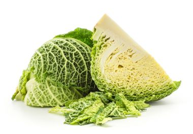 Savoy cabbage two quarters with chopped leaves stack isolated on white background fresh gree