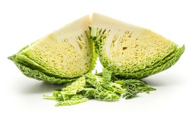 Two savoy cabbage slices with chopped leaves stack isolated on white background fresh gree