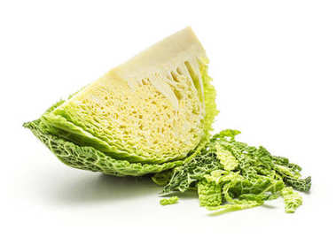 One savoy cabbage slice with chopped leaves stack isolated on white background fresh gree