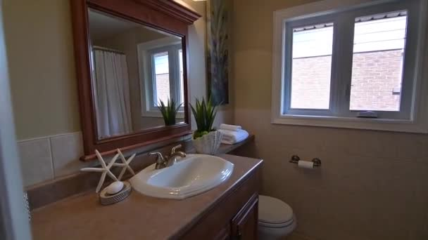 Montage of different rooms in a beautiful luxury home, shot on a moving dolly. Features a family room, kitchen, dining room, bathroom, bedroom,dining room and garden
