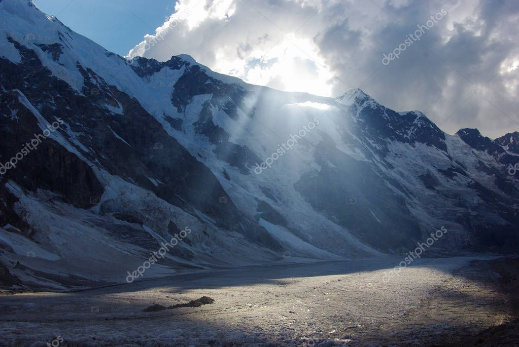 mountains and cloudy sky with sunlight