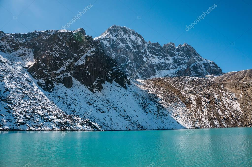 snowy mountains and lake