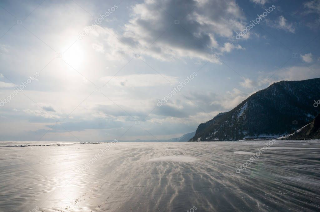 frozen sea and mountains with backlit