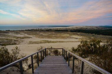 wooden pier on sandy beach