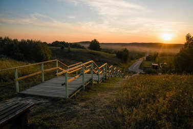 Wooden stairs to the road at beautiful sunset, Belarus, Braslav stock vector