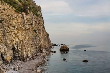 Rock cliffs on coast of sea