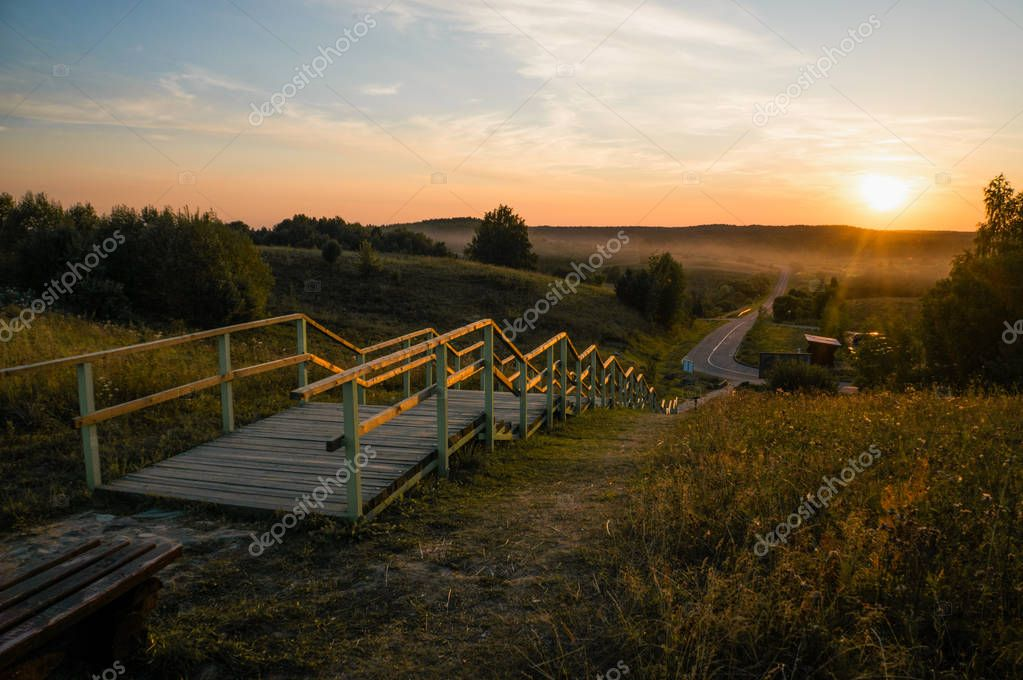 Фотообои wooden stairs at sunset