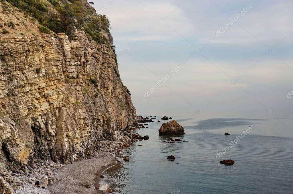 Rock cliffs on coast of sea